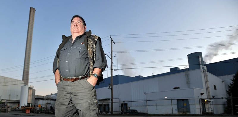 Longtime employee Walter Smith stands outside the Madison Paper Industries mill in this Nov. 2011 file photo. U.S. officials are concerned that Canadian subsidies to their paper mill will hurt Maine business.