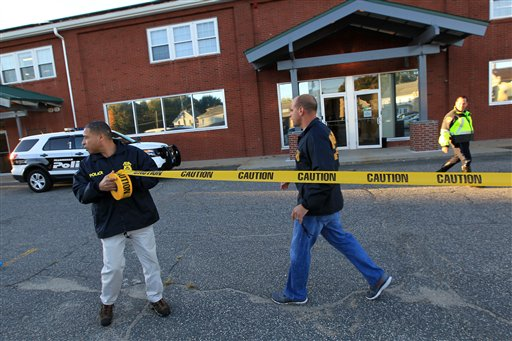 Federal agents investigate the offices of New England Compounding Center in Framingham, Mass., on Oct. 16, 2012. The company's steroid medication has been linked to a deadly meningitis outbreak.