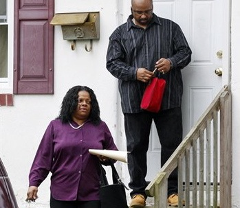Anita Saunders, mother of two teenage brothers charged in the murder of Autumn Pasquale, 12, leaves her home on Thursday in Clayton,. N.J., with her husband Richard Saunders.