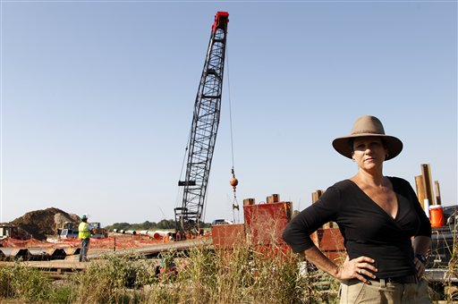 Julia Trigg Crawford stands on a road in front of a neighboring property to her family farm where work by TransCanada continues on an oil pipeline recently in Sumner, Texas.