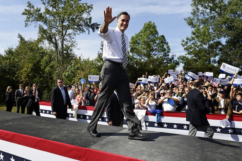 Republican presidential candidate, former Massachusetts Gov. Mitt Romney waves as he arrives for a campaign stop at Tidewater Community College in Chesapeake, Va., Wednesday, Oct. 17, 2012. (AP Photo/Charles Dharapak)