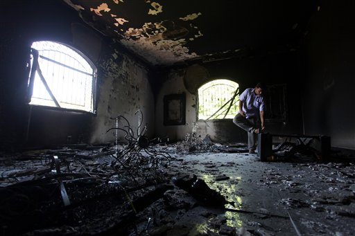 In this Sept. 13, 2012, photo, a Libyan man investigates the inside of the U.S. Consulate in Benghazi, after an attack that killed four Americans, including Ambassador Chris Stevens on the night of Tuesday, Sept. 11, 2012.