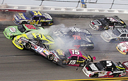 CRASH: Tony Stewart (14) flips over as Kasey Kahne (5), Clint Bowyer (15), Terry Labonte (32), Regan Smith (78), Jeff Burton (31), Jimmie Johnson (48), Dale Earnhardt Jr., (88) Paul Menard (27) and David Ragan (34) crash around him during the NASCAR Sprint Cup Series race Sunday at Talladega Superspeedway in Talladega, Ala.