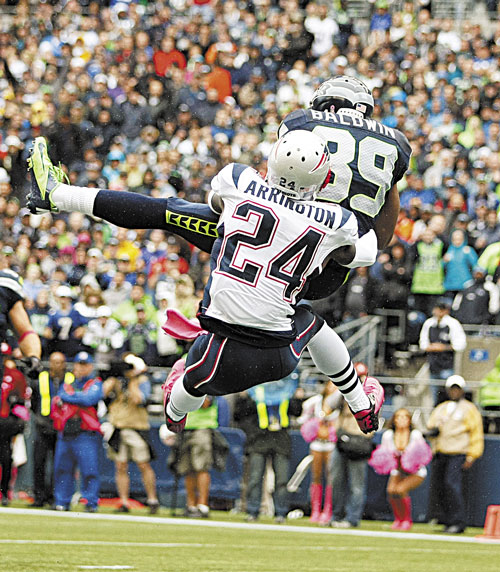 BAD DEFENSE: Seattle's Doug Baldwin (89) makes a catch for a touchdown as New England cornerback Kyle Arrington (24) tries to defend Sunday in Seattle.