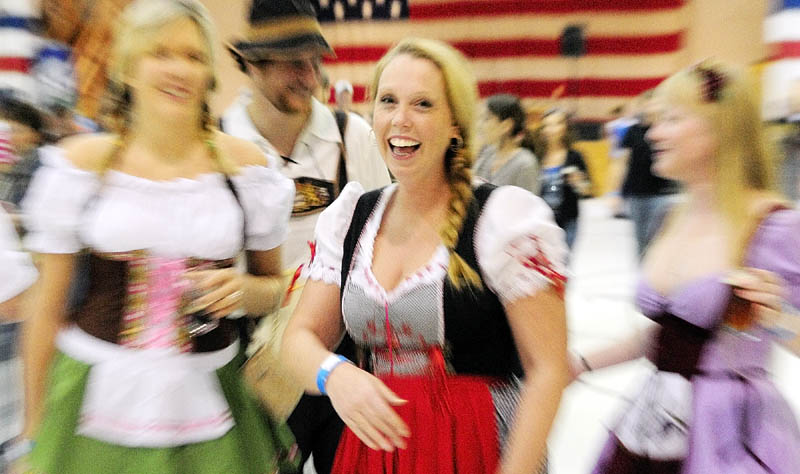 Patty Zavaletaa, of Hancock, center, said that she got the dirndl dress she is wearing while visiting Germany. She was posing with other costumed festival goers on Saturday during the Central Maine International Octoberfest at the Augusta Armory. Behind her from left are Lauren Lear, Alex Lear and Sue Magee.