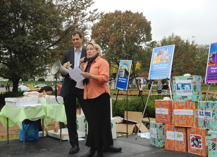 Melanie Collins, who runs Melanie's Home Childcare in Falmouth, speaks at a rally near the White House on Friday. She was among speakers calling on the U.S. Chamber of Commerce to disclose the donors behind the Chamber's political activities.