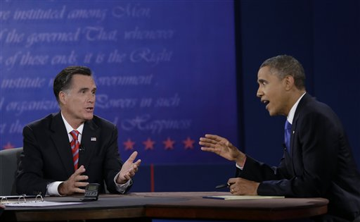 President Barack Obama, right, and Republican presidential nominee Mitt Romney discuss a point during the third presidential debate at Lynn University, Monday, Oct. 22, 2012, in Boca Raton, Fla. (AP Photo/Eric Gay)