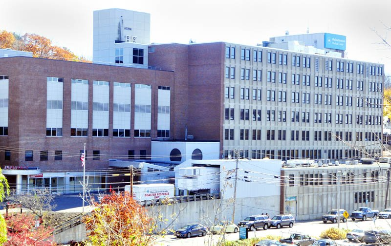 This photo taken from Memorial Bridge shows the MaineGeneral Medical Center hospital in Augusta. The property, along with MaineGeneral's Seton unit in Waterville, failed to attract the minimum $2.6 million bid in a three-day, online auction that ended Wednesday.