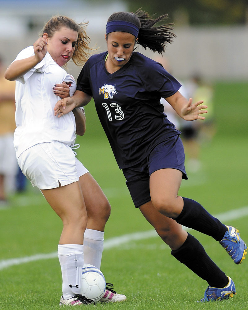 BATTLE FOR POSSESION: Mt. Blue High School's Kiana Thompson, right, battles for the ball with Cony High School's Lindsey Folsom during the Rams' 2-1 win Tuesday in Augusta.