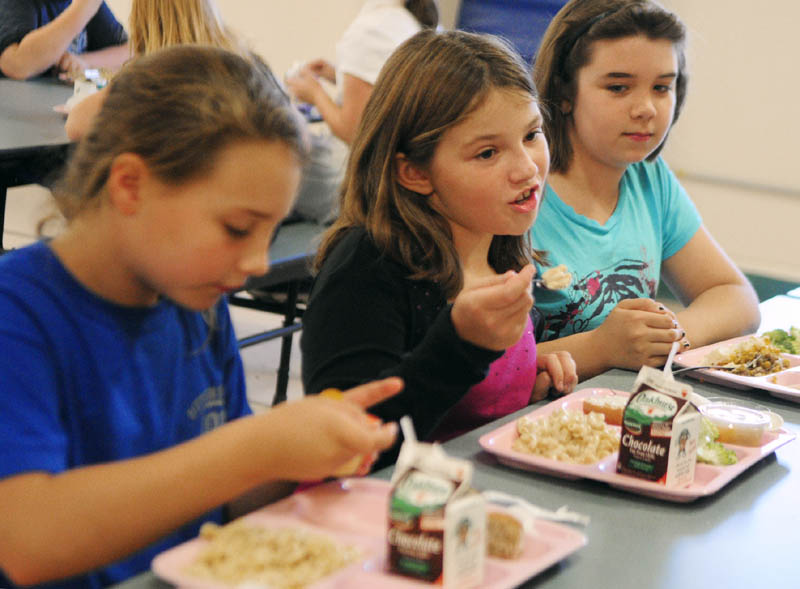 Students Lani Porter, left, Alyssa Price and Hanna Anderson talk about school lunch during an interview last week at Pittston Consolidated School.