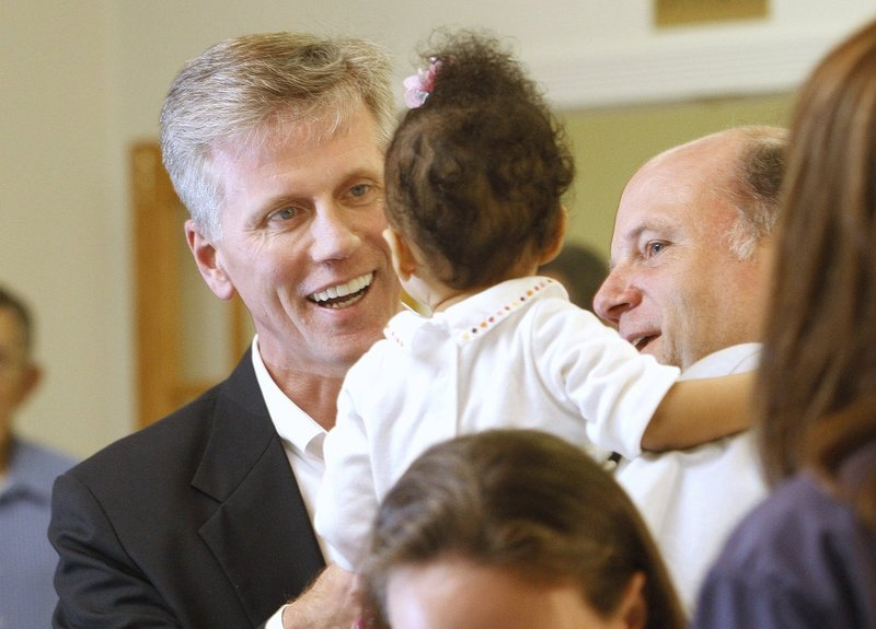 Charlie Summers greets Brooke Briggs, of Biddeford, and her father, Jason, after arriving at the Maine Military Museum, the headquarters for Summers' primary election night, on June 12.