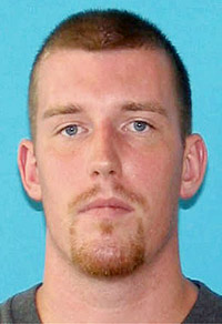 This image provided by the Bangor Police Department shows Nicholas Sexton, 31, of Warwick, R.I. According to police officials, Sexton, 31, is one of two men wanted in connection with the slayings of three people in Maine whose bodies were found in a burning car.