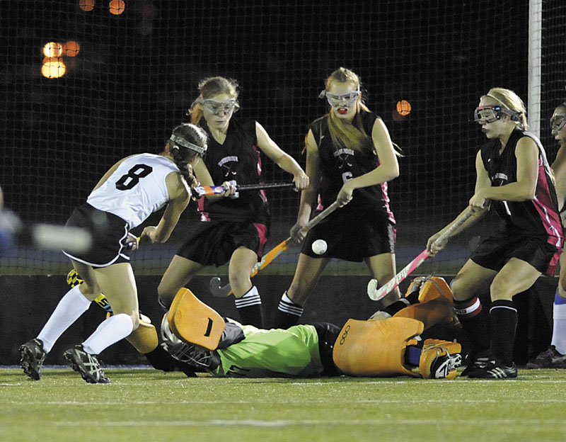 Skowhegan High School field hockey player Brooke Michonski (8) fires a shot over Scarborough goalie Shannon Hicks in the firts period of their State Class A Championship game in Orono, Maine, Saturday, Oct.27, 2012.