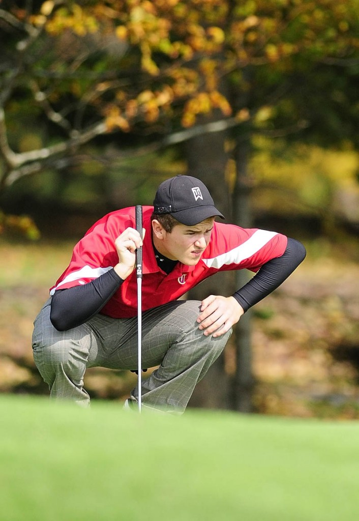 Cony's Zach Gagne lines up a putt during state class A team golf championships on Saturday morning at Natanis Golf Club in Vassalboro.