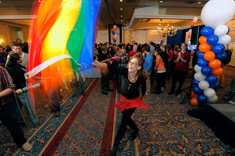 Angel Putney of Portland, who said she usually twirls fire, took to twirling a gay pride flag while waiting for election results at the Mainers United for Marriage Campaign party at the Holiday Inn by the Bay Tuesday, November 6, 2012.