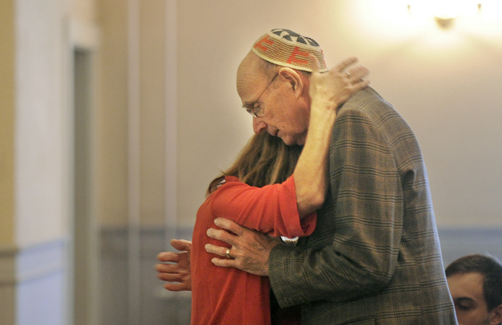 Alison Kuller, Jeff Kuller's wife, receives a hug from Merrill Kuller, his father, after Alison spoke at a memorial service for Jeff Kuller at the Camden Opera House on Thursday.