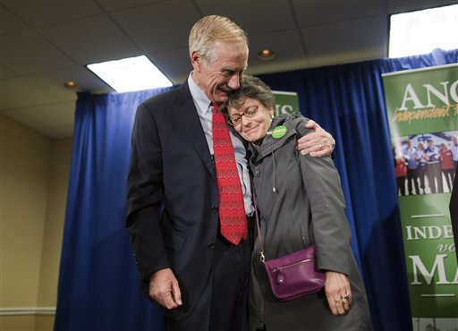 Independent Senator-elect Angus King hugs his wife, Mary Herman, after he spoke at a news conference, Wednesday, Nov. 7, 2012, in Freeport, Maine. King says he's heading to Washington this weekend and could decide as soon as next week, or after Thanksgiving, on which party he'll align himself with. The former two-term governor overcame challenges from Republican Secretary of State Charlie Summers and Democratic state Sen. Cynthia Dill to succeed retiring Republican Sen. Olympia Snowe. (AP Photo/Robert F. Bukaty)