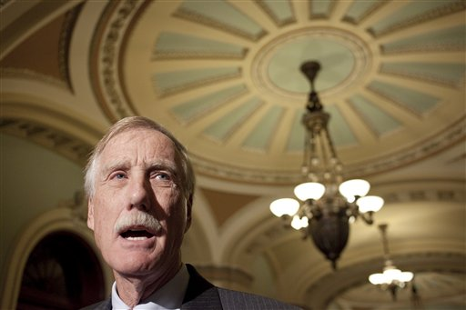 Sen.-elect Angus King, I-Maine announces on Capitol Hill in Washington, Wednesday, Nov. 14, 2012, that he will caucus with the Democrats in the 113th Congress. (AP Photo/Harry Hamburg)