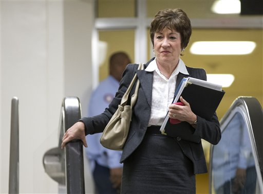 Sen. Susan Collins, R-Maine, ranking Republican on the Senate Homeland Security and Governmental Affairs Committee, walks to a meeting on Capitol Hill with UN Ambassador Susan Rice.