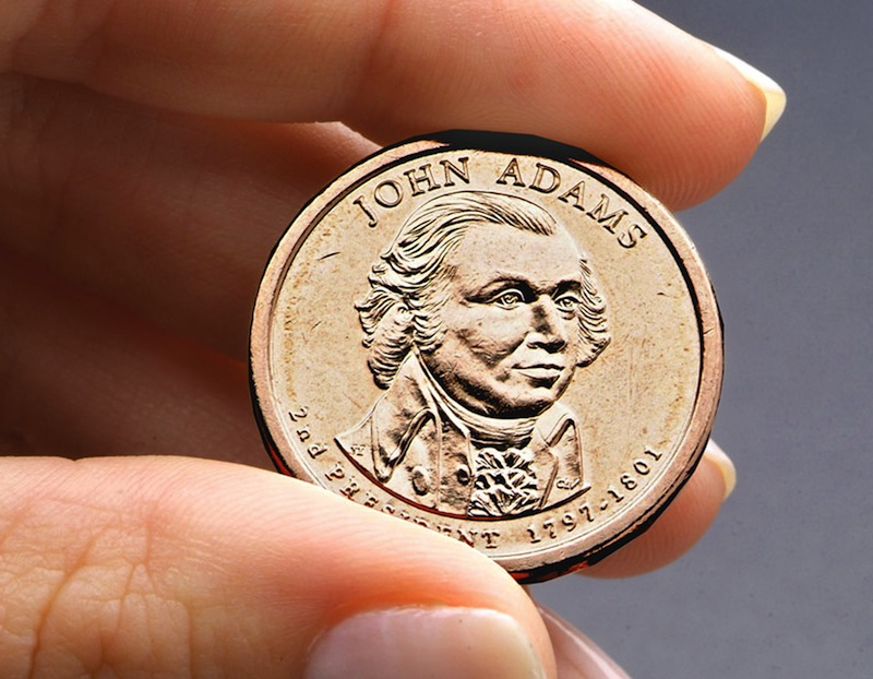 This undated file photo provided by the U.S. Mint shows the President John Adams presidential $1 coin. Congressional auditors say doing away with dollar bills entirely and replacing them with dollar coins could save taxpayers some $4.4 billion over the next 30 years. (AP Photo/US Mint, File)