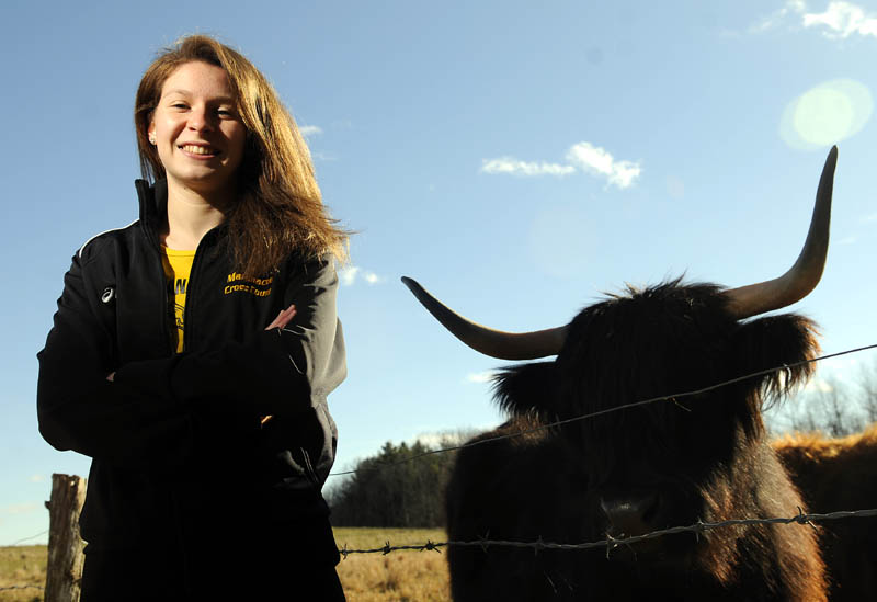 Maranacook Community High School's Caroline Colan is the Kennebec Journal Girls Cross Country Runner of the Year.