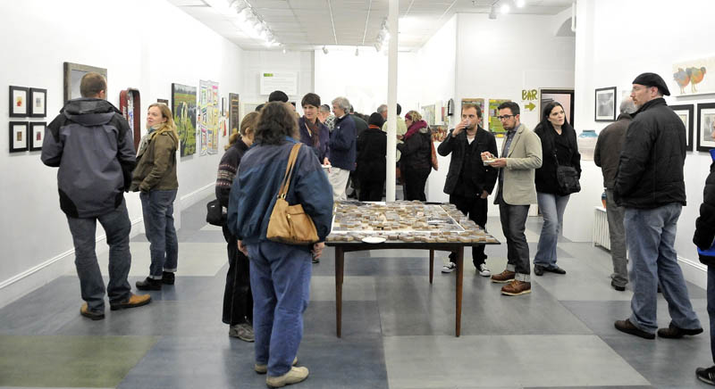 Art lovers gathered at Common Street Arts in Waterville for the opening of a new exhibit, featuring a collection of art inspired by local farms over the last growing season, on Saturday.