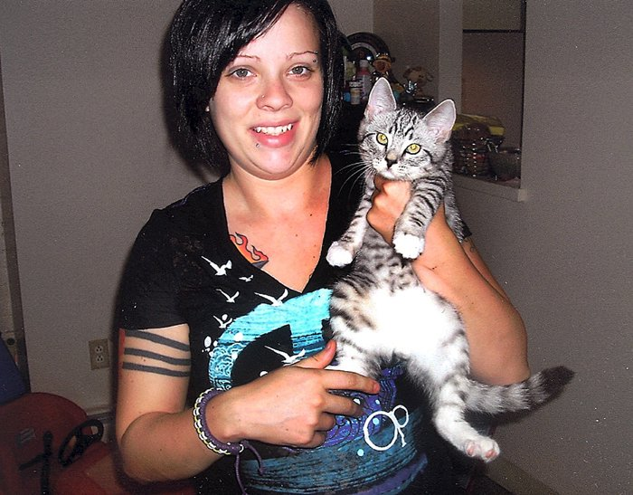 Samantha Folsom holds her kitten, Gadget, in this 2010 photo.