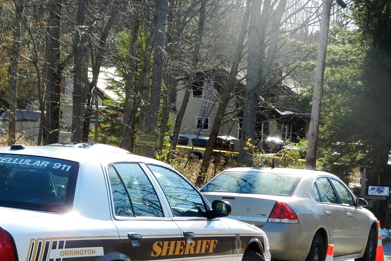 Authorities respond to a fire on Dow Road in Orrington on Saturday. The fire started when pizza boxes near a woodstove were ignited.