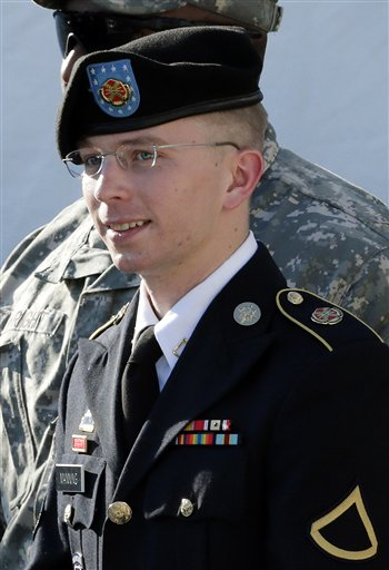 Army Pfc. Bradley Manning is escorted out of a courthouse in Fort Meade, Md., after a pretrial hearing on June 25, 2012.