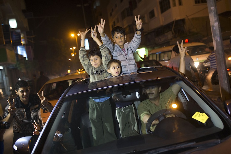 Palestinians celebrate the cease fire agreement between Israel and Hamas in Gaza City, Wednesday, Nov. 21, 2012. Israel and the Hamas militant group agreed to a cease-fire Wednesday to end eight days of the fiercest fighting in nearly four years, promising to halt attacks on each other and ease an Israeli blockade constricting the Gaza Strip. (AP Photo/Bernat Armangue)