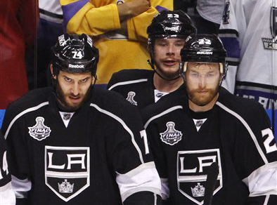 Los Angeles King players Dwight King, left, Dustin Brown and Trevor Lewis. The NHL announced Friday that it has canceled all games through through Dec. 14 because of the labor dispute between owners and players.