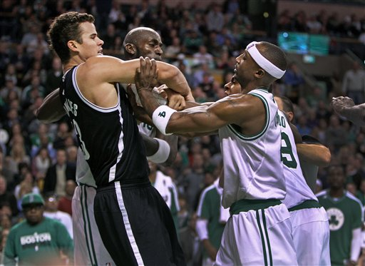 Boston Celtics' Kevin Garnett, center, Rajon Rondo, front right and Jason Terry (partially obscured, back right, confront Brooklyn Nets' Kris Humphries, front left, during an NBA game in Boston, Wednesday, Nov. 28, 2012. (AP Photo/The Globe/Jim Davis) NO SALES; MAGAZINES OUT; INTERNET OUT; BOSTON HERALD OUT; QUINCY OUT