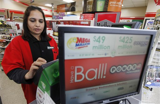 Cashier Farah Husain works a lottery machine for a powerball ticket at a convenience store Tuesday in Richmond, Va.