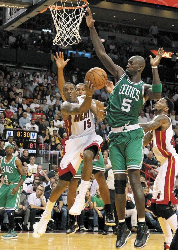 DEFEND: Kevin Garnett, right, and the Boston Celtics will try to bounce back from their season-opening loss to the Miami Heat when they host the Milwaukee Bucks tonight. Miami Heat vs. Boston Celtics 1