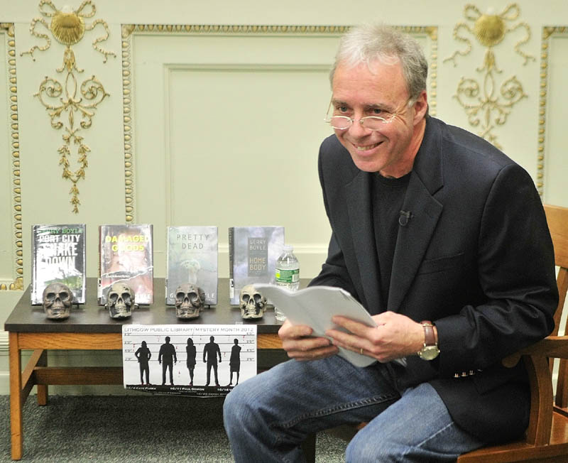 Crime fiction writer Gerry Boyle reads from his upcoming Jack McMorrow novel during a recent event in the reading room at Lithgow Public Library in Augusta.