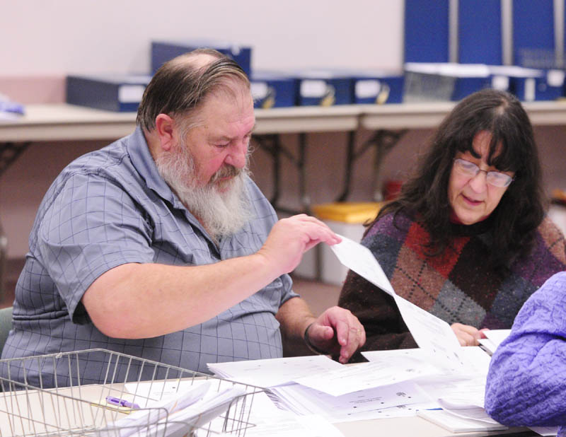 Volunteer counters Carl Pettengill, of Farmingdale, left, and Rita Moran, of Winthrop, sort through ballots in the House District 80 race between Republican incumbent Rep. Melvin Newendyke and Democratic challenger Rachel Sukeforth.