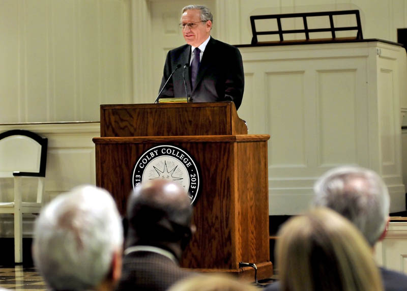 Author Bob Woodward,who as a Washington Post reporter helped unveil the Watergate scandal that brought down Richard Nixon's presidency, addresses a packed Lorimer Chapel at Colby College in Waterville on Sunday. Woodward received the college's Lovejoy Award for journalism.