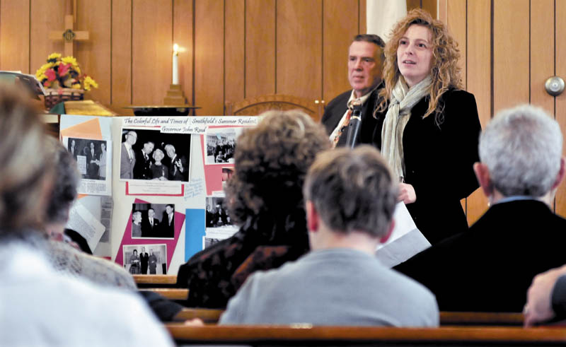Speaking next to some memorabilia of former Gov. John Reed, Christine Keller fondly recalls him during a celebration of his life at the Smithfield Baptist Church on Sunday. Behind Keller is the Rev. Bert Brewster.