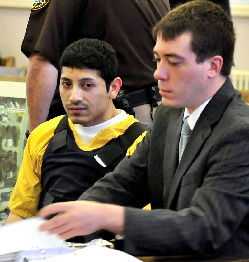 Defendant Juan Contreras, left, with his attorney Chris Berrymint during the first day of Contreras trial in the stabbing death of Grace Burton on Monday in Franklin County Superior Court in Farmington on Monday.