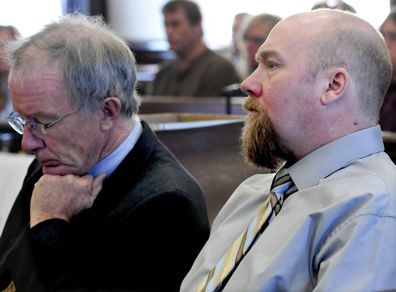 Murder defendant Robert Nelson, right, listens to opening statements in his trial in the death of Everett Cameron on Monday in Somerset County Superior Court in Skowhegan. At left is attorney John Alsop.