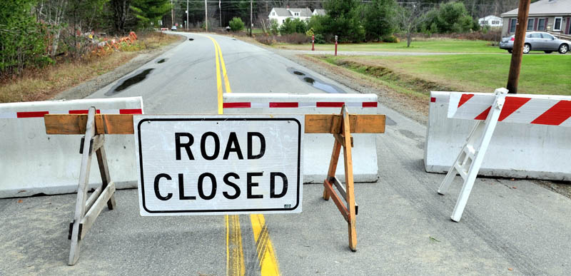 The Whittier Road in Farmington is now closed to traffic, due to a nearby unstable and eroding Sandy River embankment.