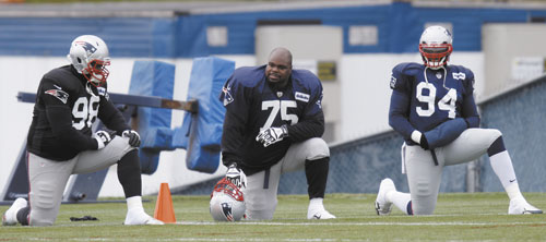 TALKING SHOP: New England Patriots defensive tackle Vince Wilfork (75) talks with defensive end Justin Francis (94) during practice Wednesday at the team's training facility in Foxborough, Mass.