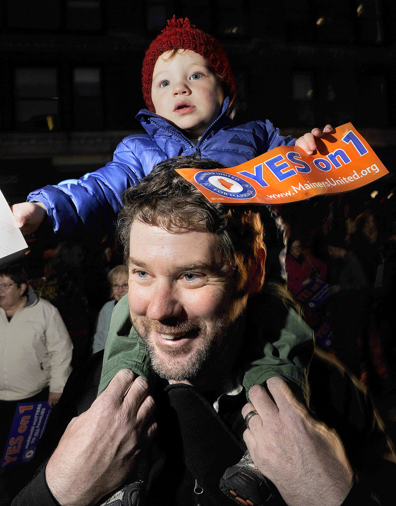 Attendees at a same-sex marriage rally Thursday night in Portland's Monument Square included Matt Pines, who brought his son, Tanner, 18 months.