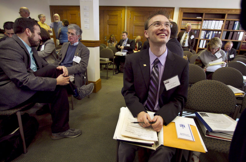 State Rep.-elect Justin Chenette, D-Saco, right, chats with a colleague during freshman orientation Thursday at the State House. Chenette, 21, is the Legislature's youngest member.