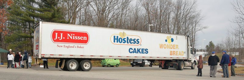 "A tractor-trailer enters the Hostess plant in Biddeford, where employees continued to walk a picket line Friday after the company announced it would begin liquidation proceedings. ""We still have a trust issue,"" said John Jordan, an agent for the bakery's union. ""So we will be out here until we know for sure,"" he said."
