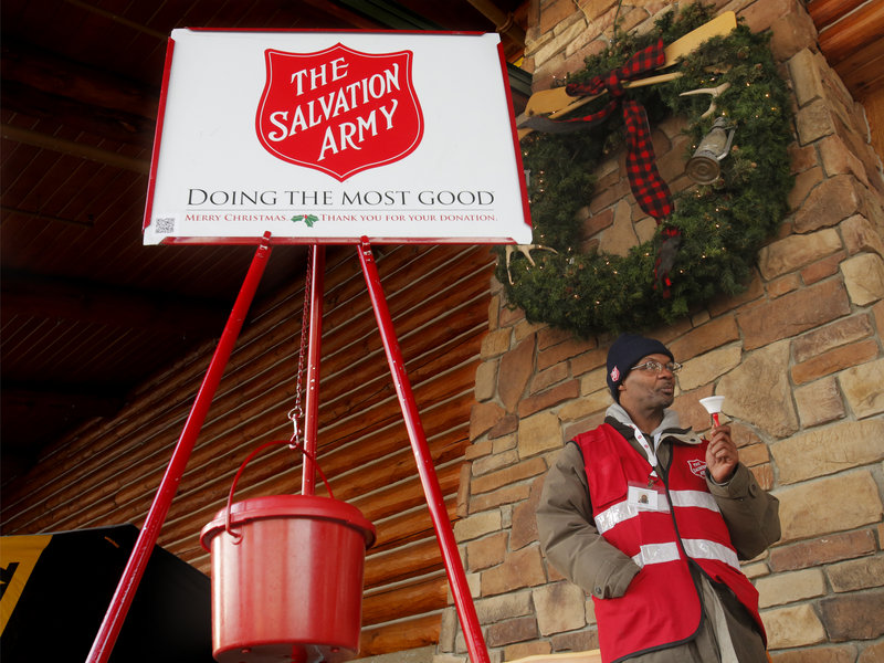"Danny Mitchell rings the bell at a Salvation Army donation kettle at Cabela's in Scarborough on Wednesday. ""This is the time of year when we tell our stories and remind people how life is out there for many of us,"" said Maj. Steve Ditmer of the Salvation Army's Portland Corps."
