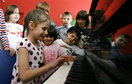 Orphan children play music at an orphanage in the southern Russian city of Rostov-on-Don on Wednesday.
