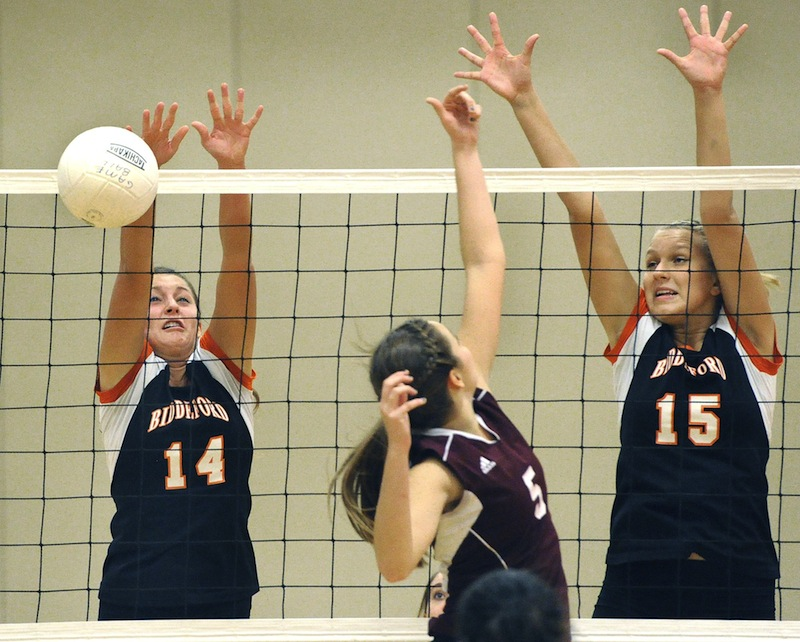 Int his file photo, Biddeford's No. 14 Mariah Hebert blocks a shot from Gorham's No. 5 Quincy Shaw in the state semifinals Wednesday, Oct. 24, 2012. Hebert was named Maine's Gatorade Volleyball Player of the Year on Wednesday, Dec. 12, 2012.