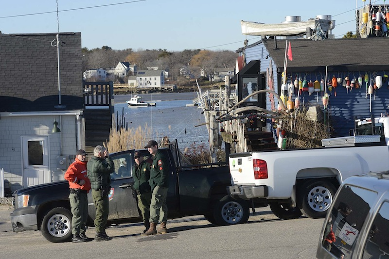Staff Photo by Shawn Patrick Ouellette: Members of the Maine Marine Patrol and Maine Game Warden Services talk in Cape Porpoise Monday, December 24, 2012. Zachary Wells and Prescott Wright, have been missing from Kennebunkport since Wednesday.