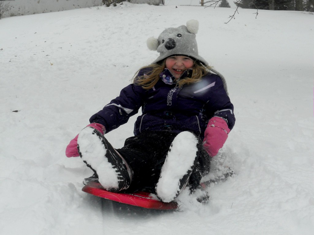 Cassandra Paul, 7, of Clinton, tries out the new sled she got for Christmas on Thursday.